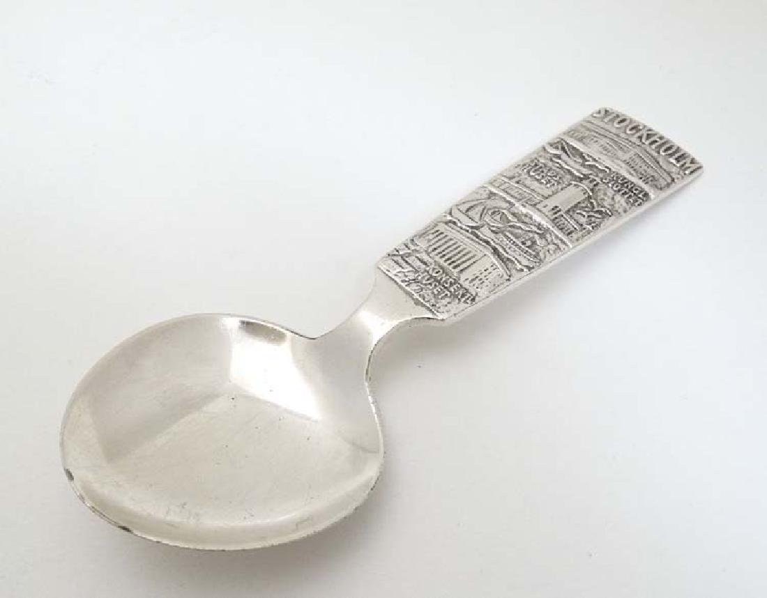 A Souvenir silver plate spoon with scenes of Stockholm