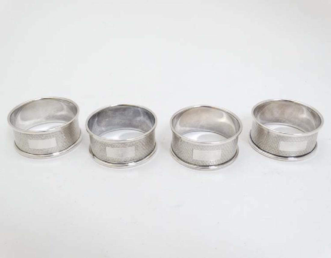 4 silver napkin rings with engine turned decoration