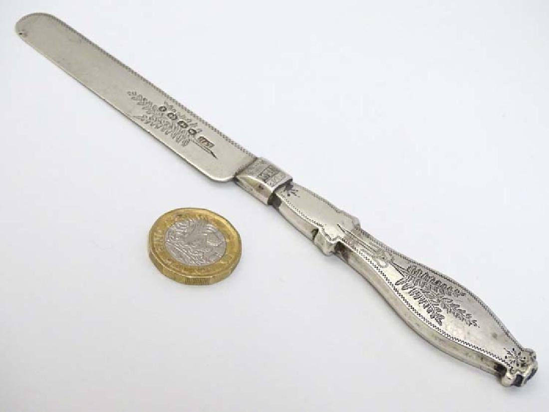 A silver knife with unusual shaped handle. Hallmarked