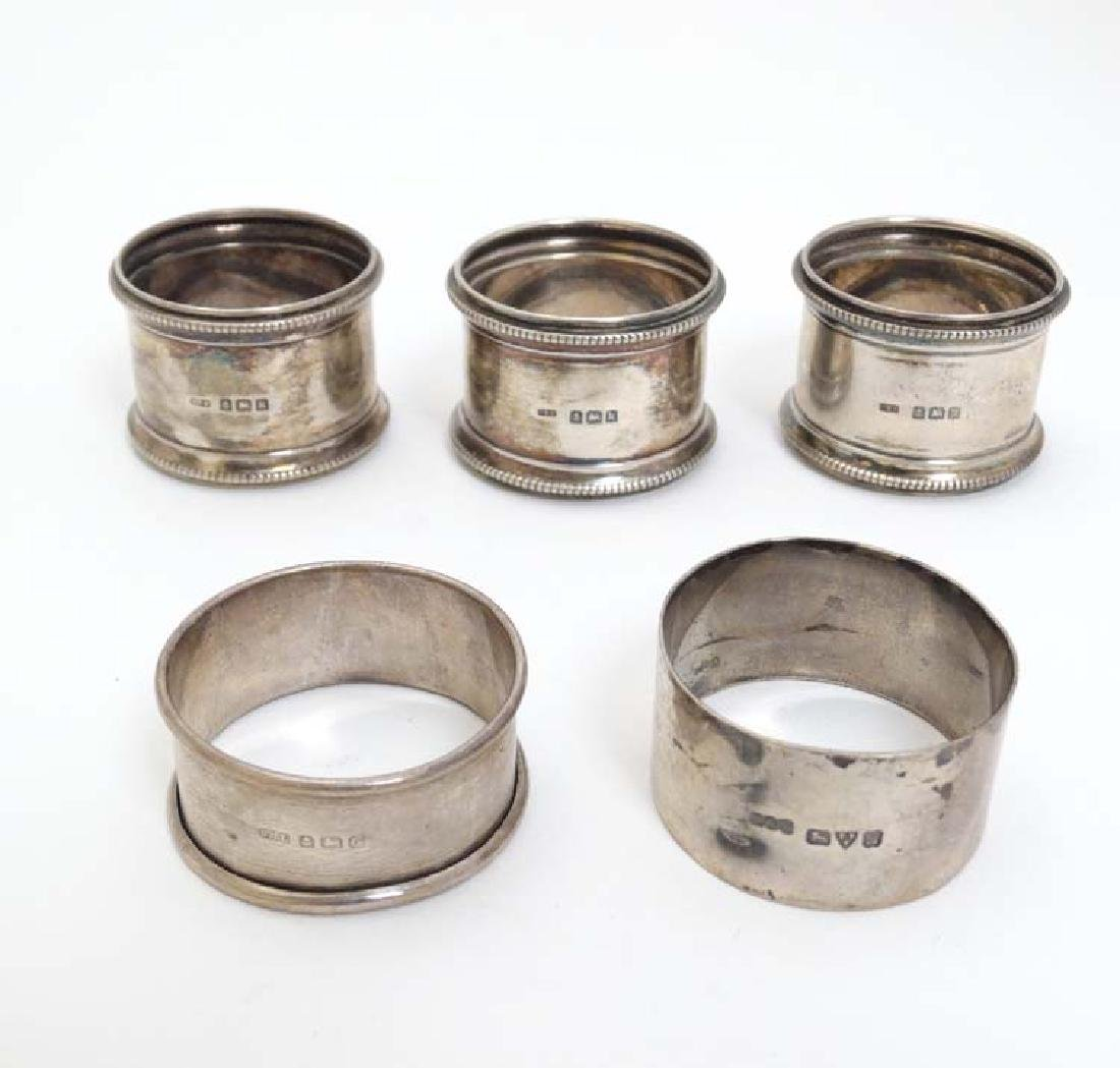 5 silver napkin rings to include 3 x  hallmarked