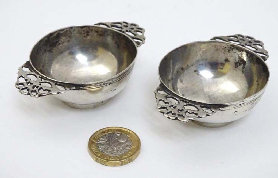 A pair of Victorian silver twin handled wine tasters