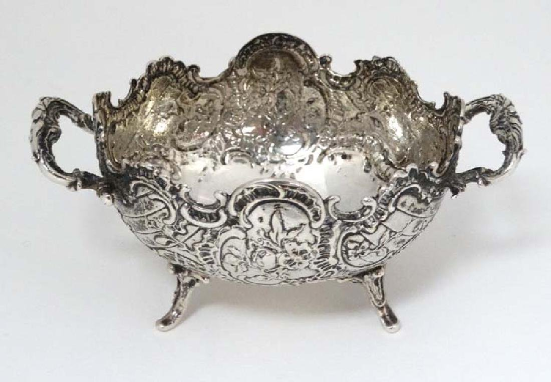 A Continental white metal twin handled dish,
