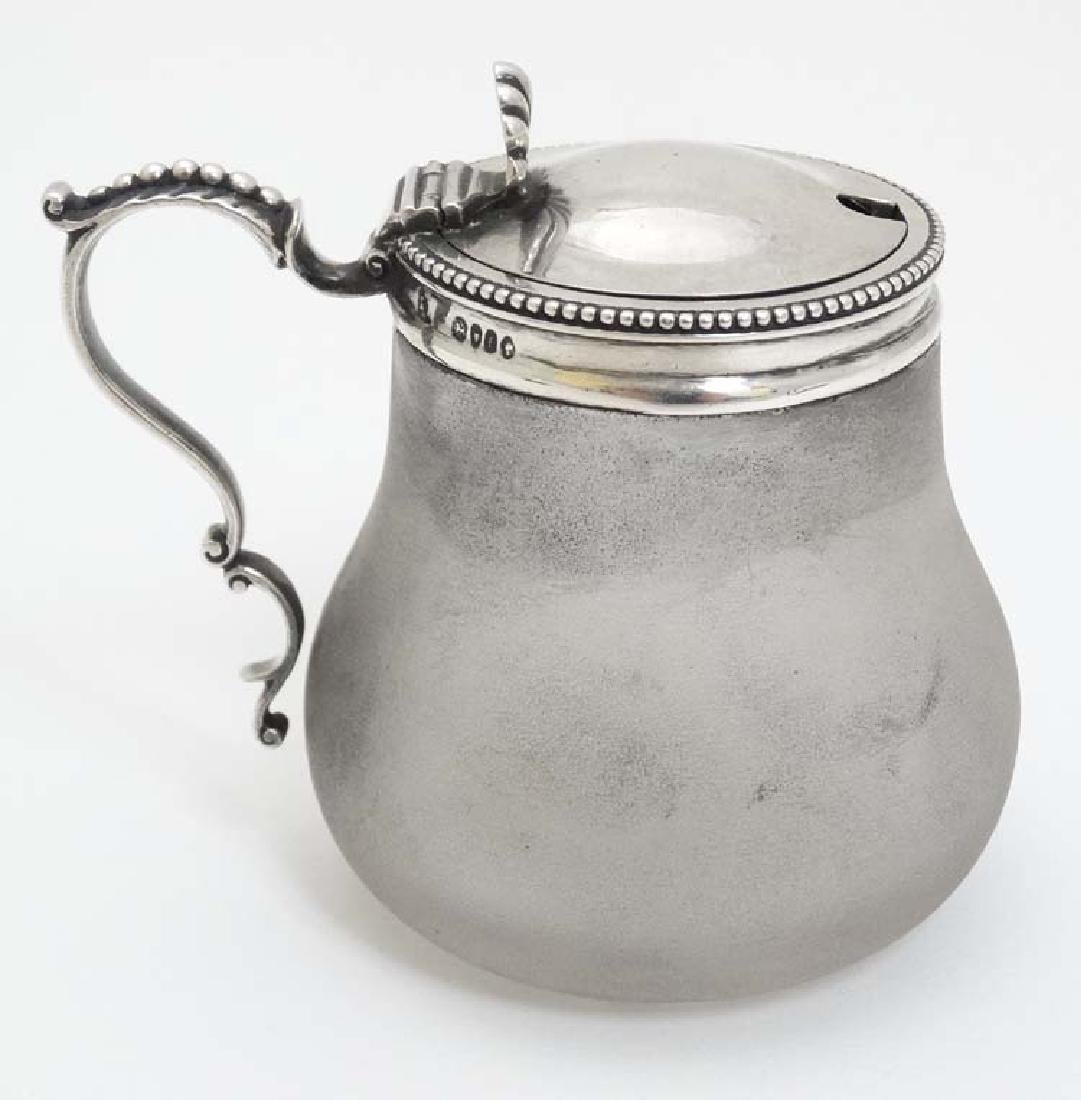 A Victorian frosted glass mustard pot with silver top