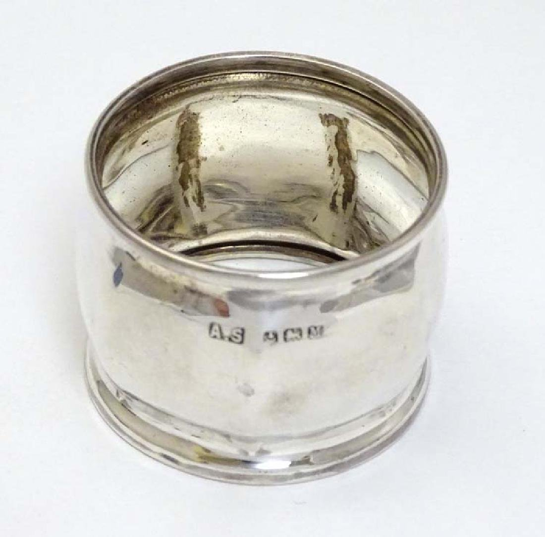 A silver napkin ring hallmarked Birmingham 1936 maker