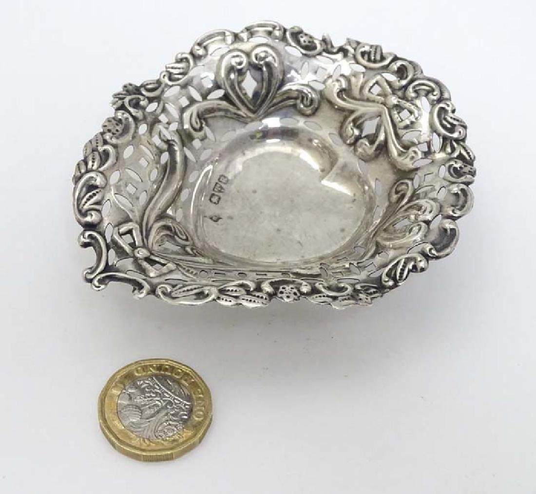 A silver bon bon dish of heart form with embossed