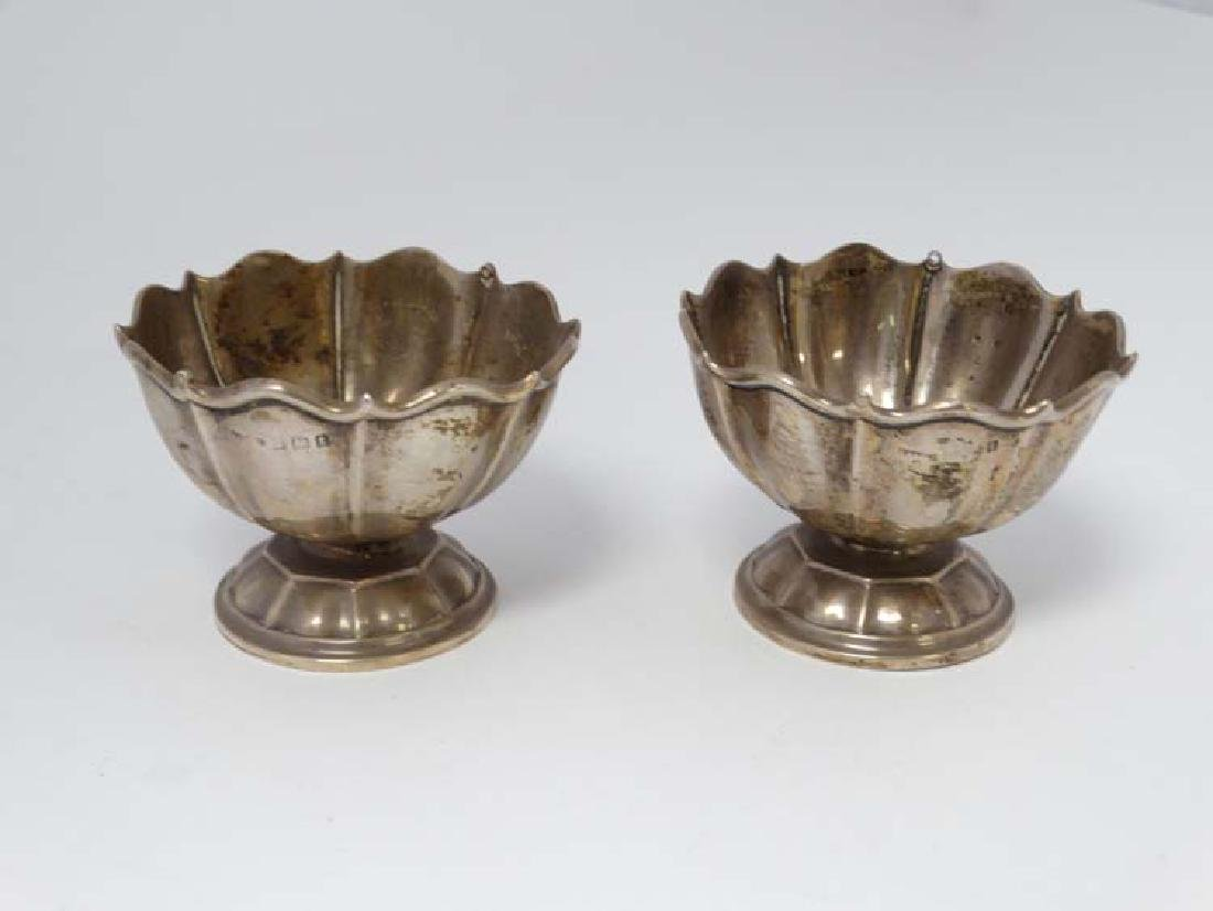 A pair of silver small pedestal dishes hallmarked