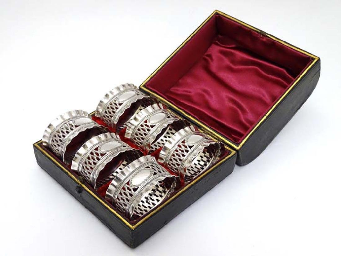 A cased set of 6 silver plate napkin rings with