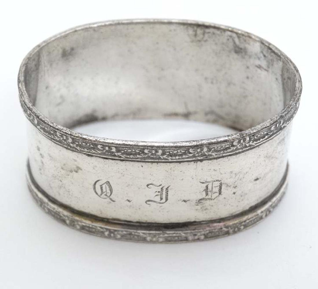 A silver napkin ring of ovoid form. Hallmarked