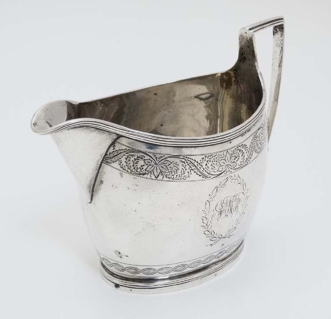 A Geo III silver cream jug  with engraved decoration - 2