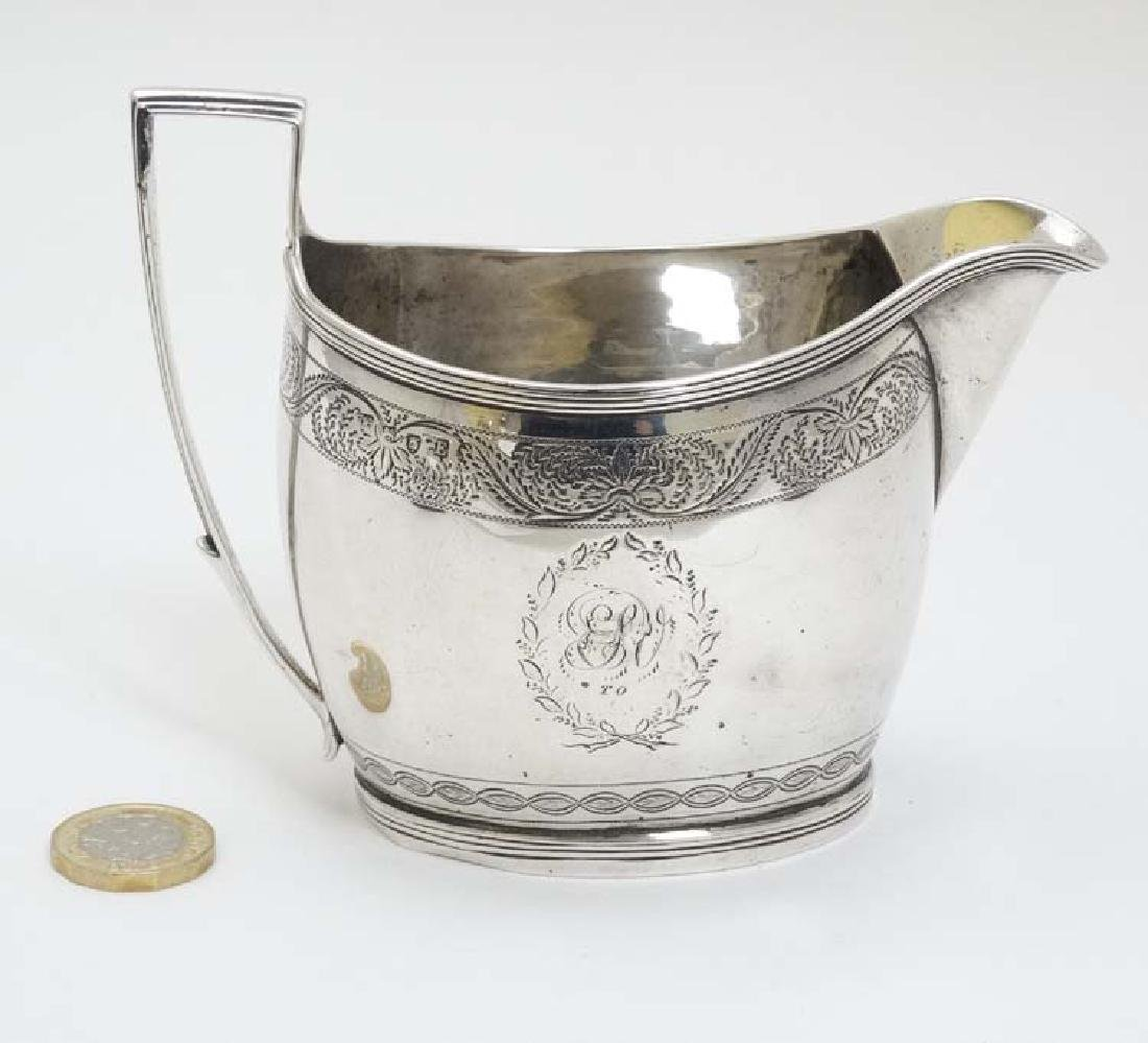 A Geo III silver cream jug  with engraved decoration - 3