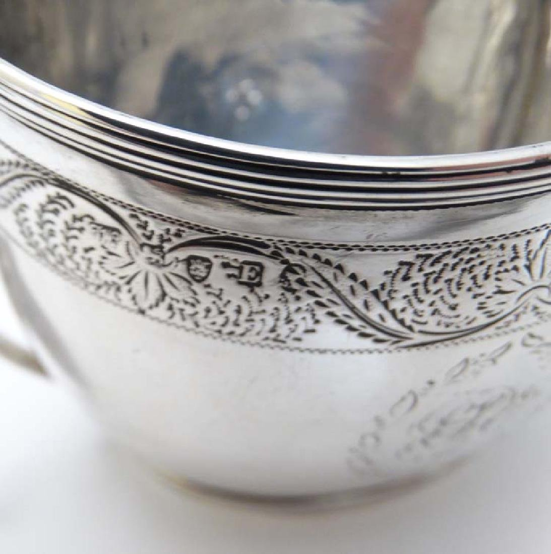 A Geo III silver cream jug  with engraved decoration - 5