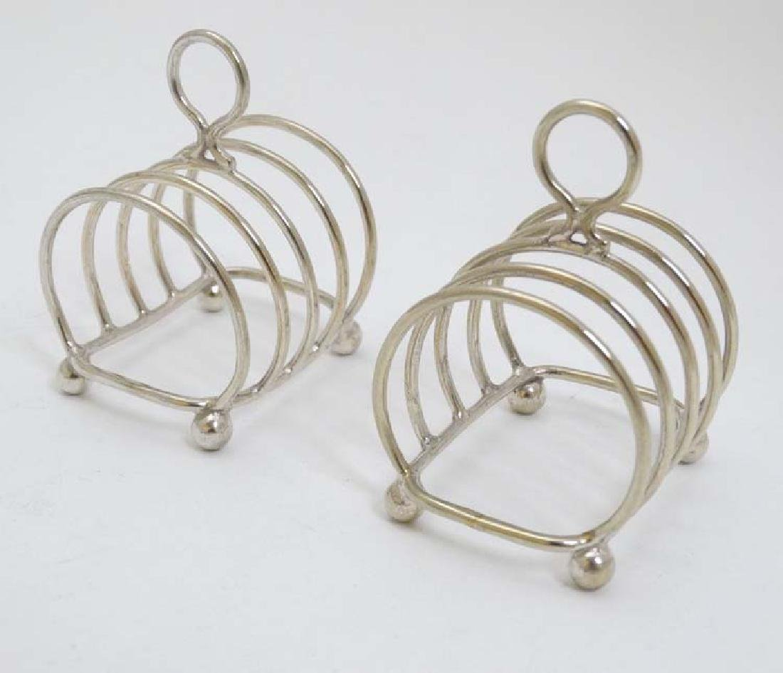 A pair of small silver plated 4 slice toast racks