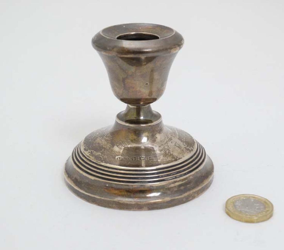 A silver candlestick  hallmarked Birmingham 1970 maker