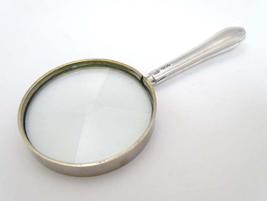 A magnifying glass with silver handle 5 1/2'' long - 3