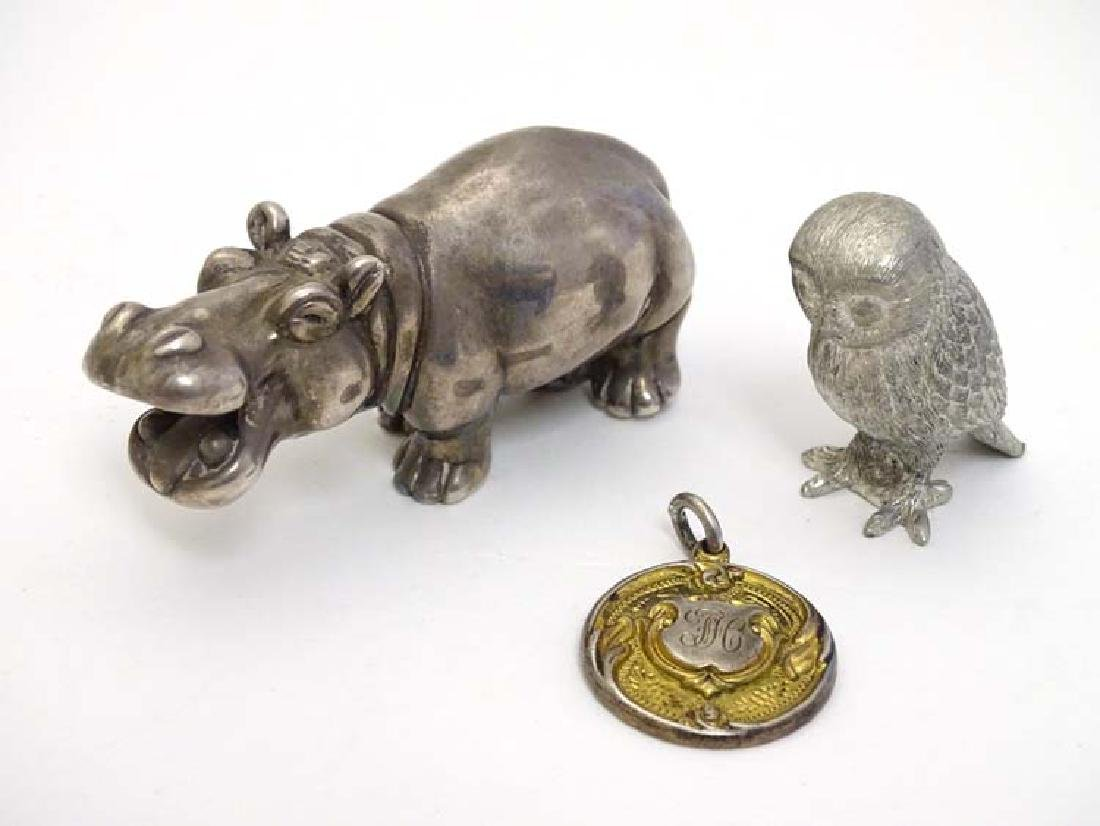 A 925 silver model of a hippo 3'' long, together with a