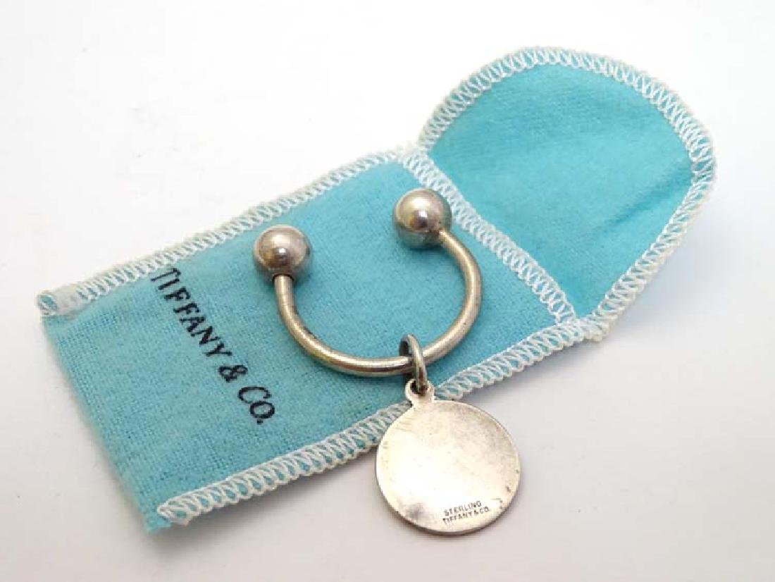 A silver keyring marked 'Sterling Tiffany & Co'