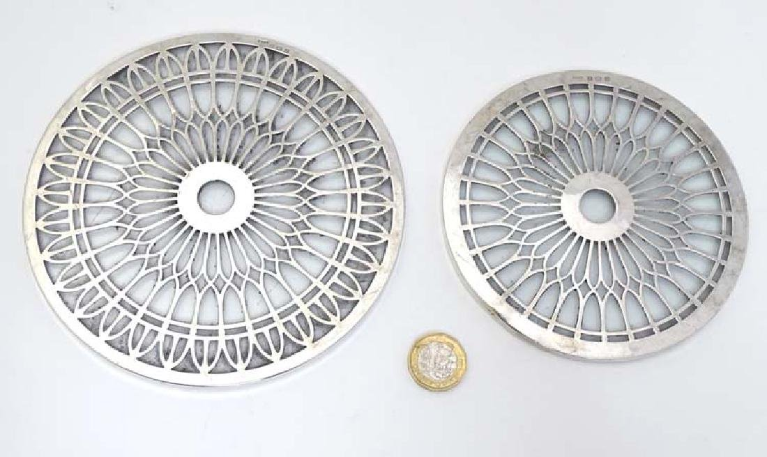 Two glass stands /  coasters with silver decoration