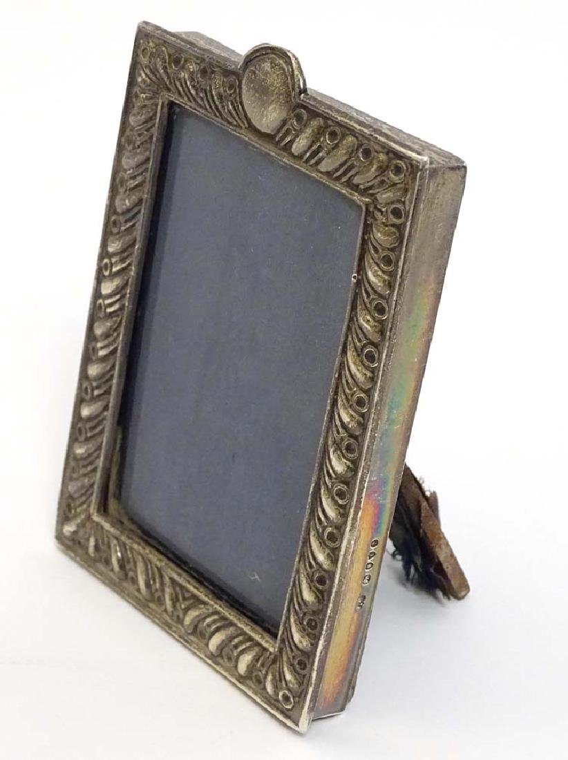 A Victorian silver photograph frame with embossed