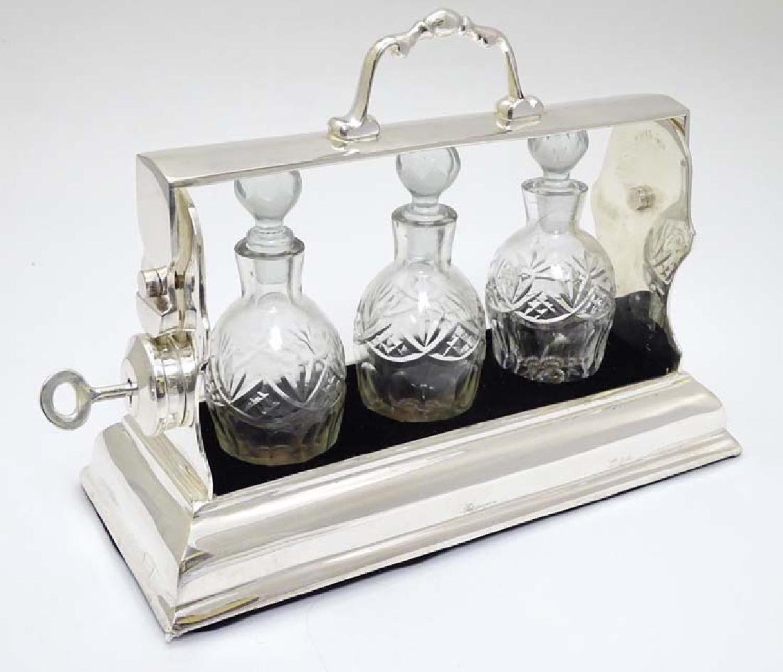 A 21stC silver plate  small tantalus with 3 cut glass