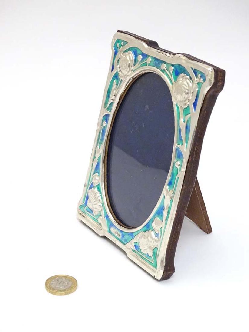 A 21stC Art Nouveau style silver photograph frame with