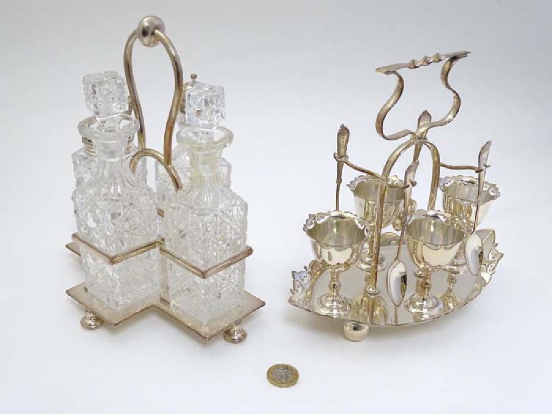 A silverplate egg cruet, the stand comprising 4