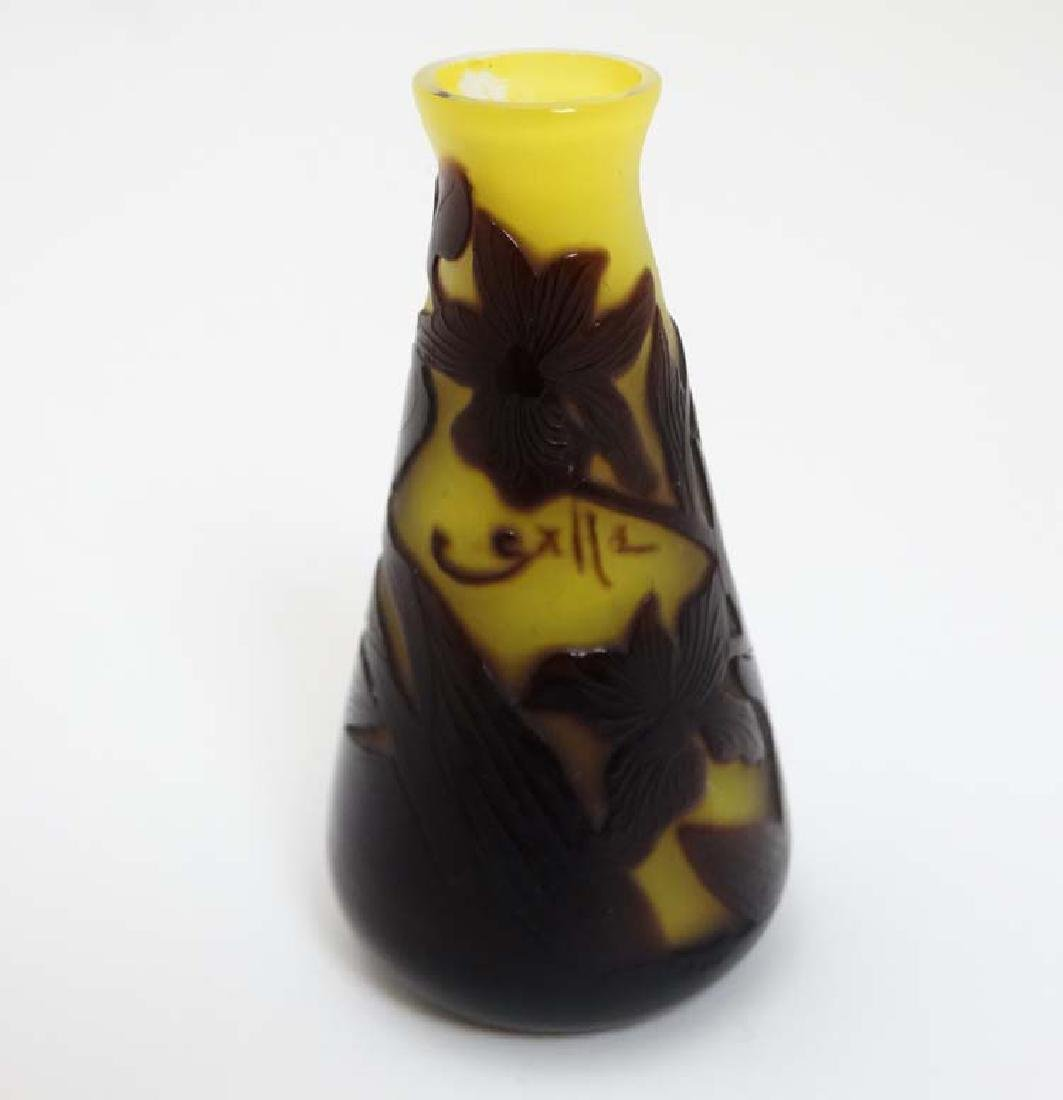 A small cameo glass vase, the yellow ground with brown
