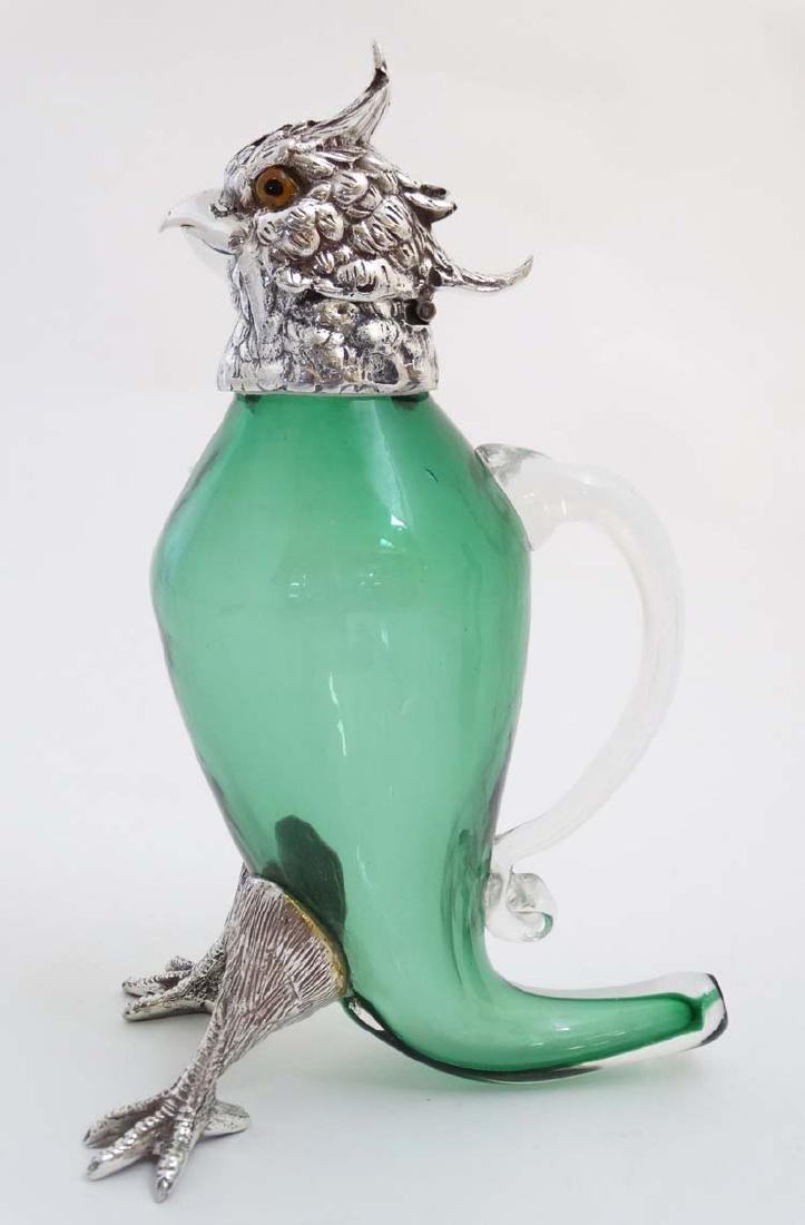 A 21stC novelty green glass claret jug with silver