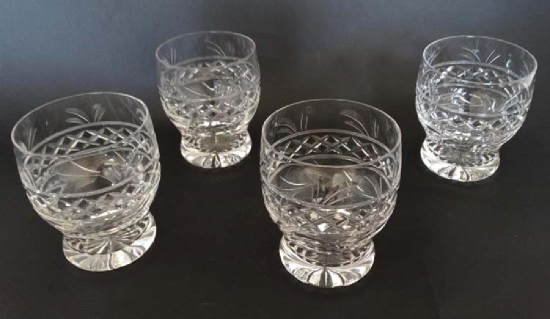 A collection of 4 crystal tumblers , each standing 4''