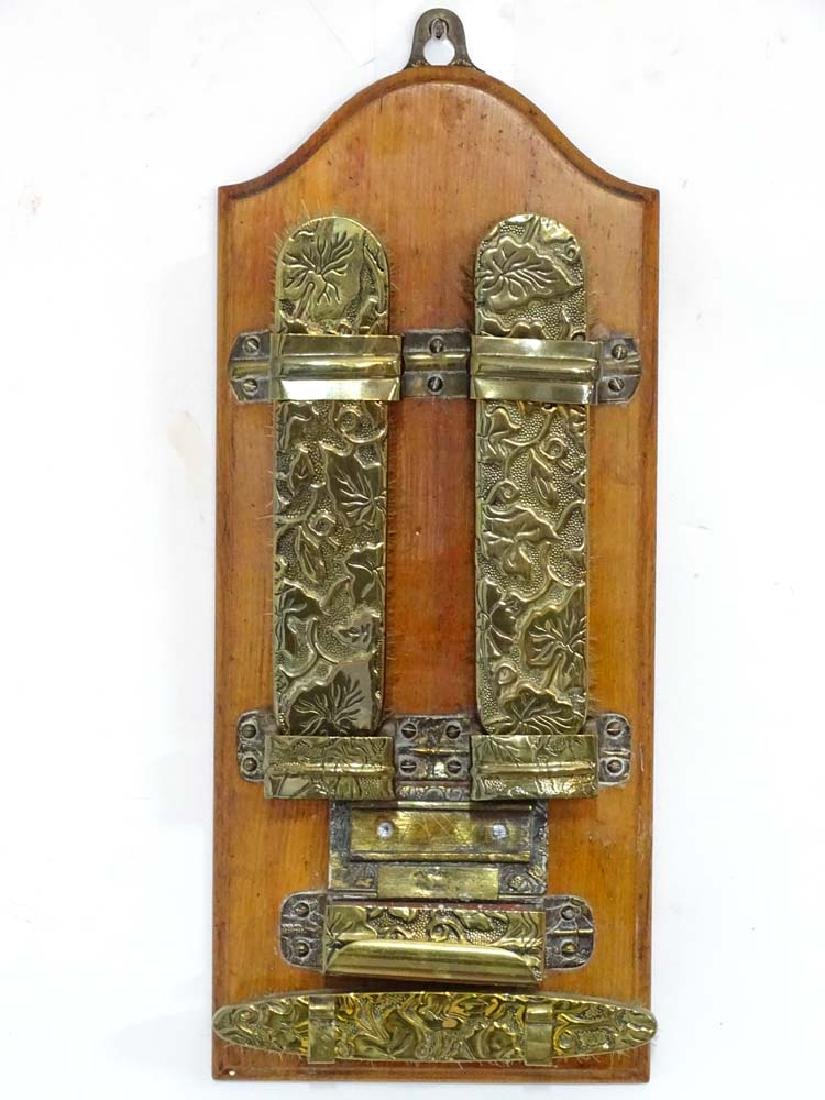 An early 20thC wall mounted brass and Mahogany hall