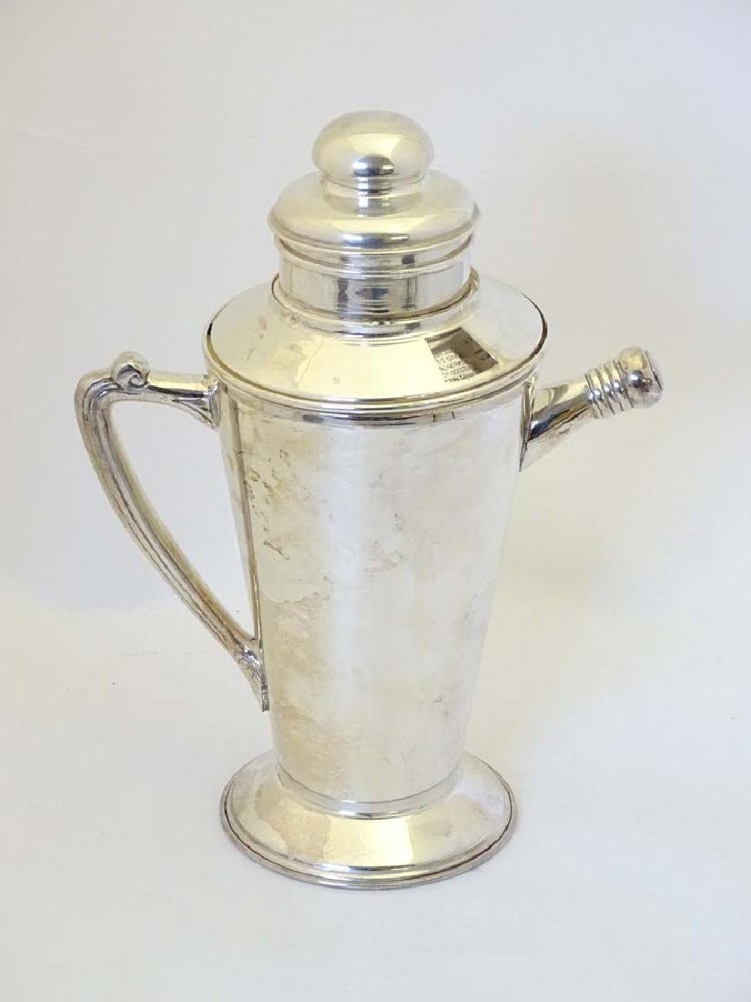 An Art Deco style Silver plate cocktail shaker with