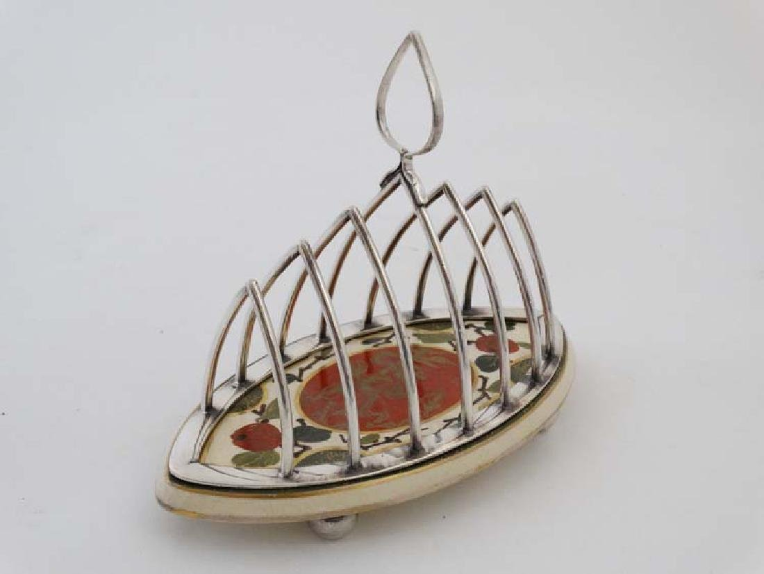 An early 20thC Taylor and Tuncliffe toast rack with