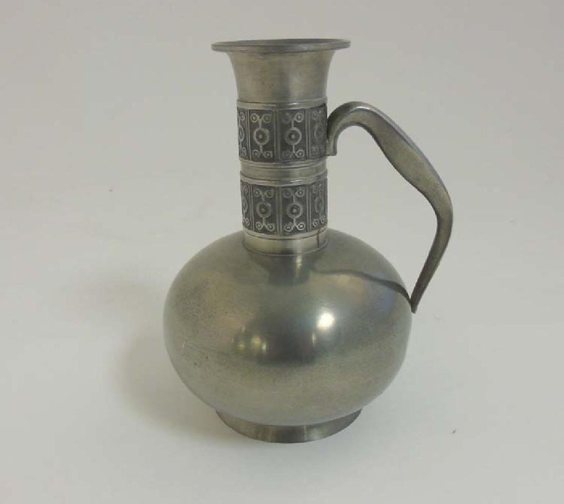 Decorative Metalware :  A Norwegian pewter handled jug