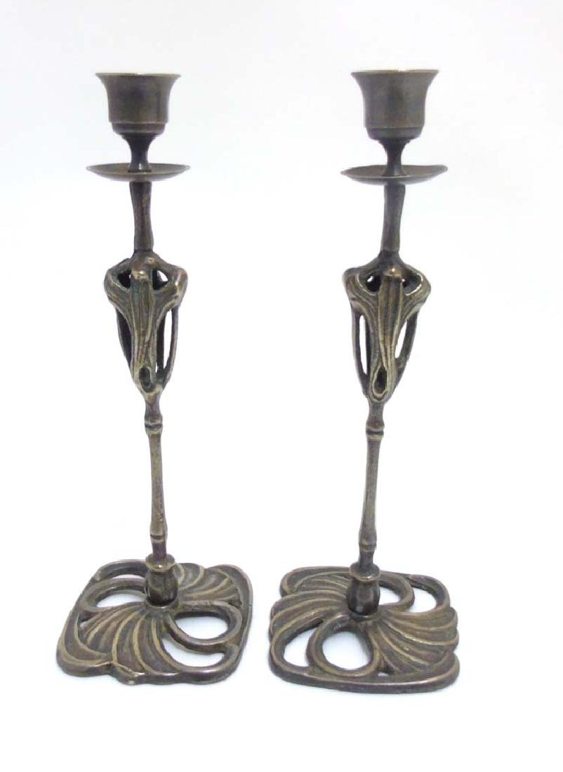 A pair of early 20thC silver plate and brass cast and