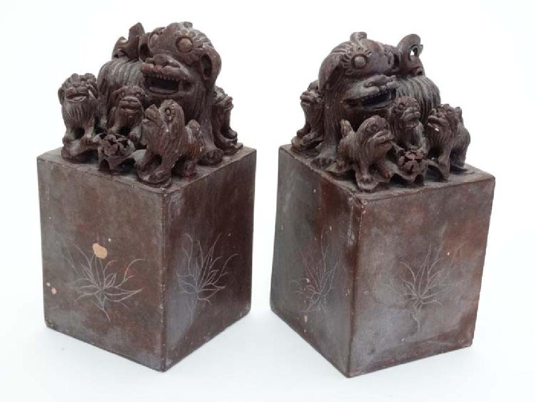 A pair of Chinese red soapstone scroll/bookends?