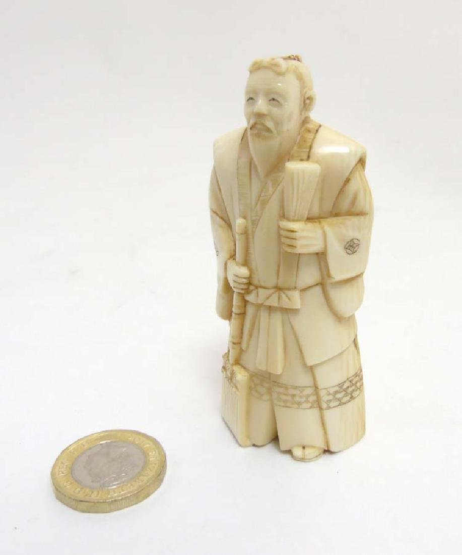 A signed Japanese Meiji okimono of a standing male