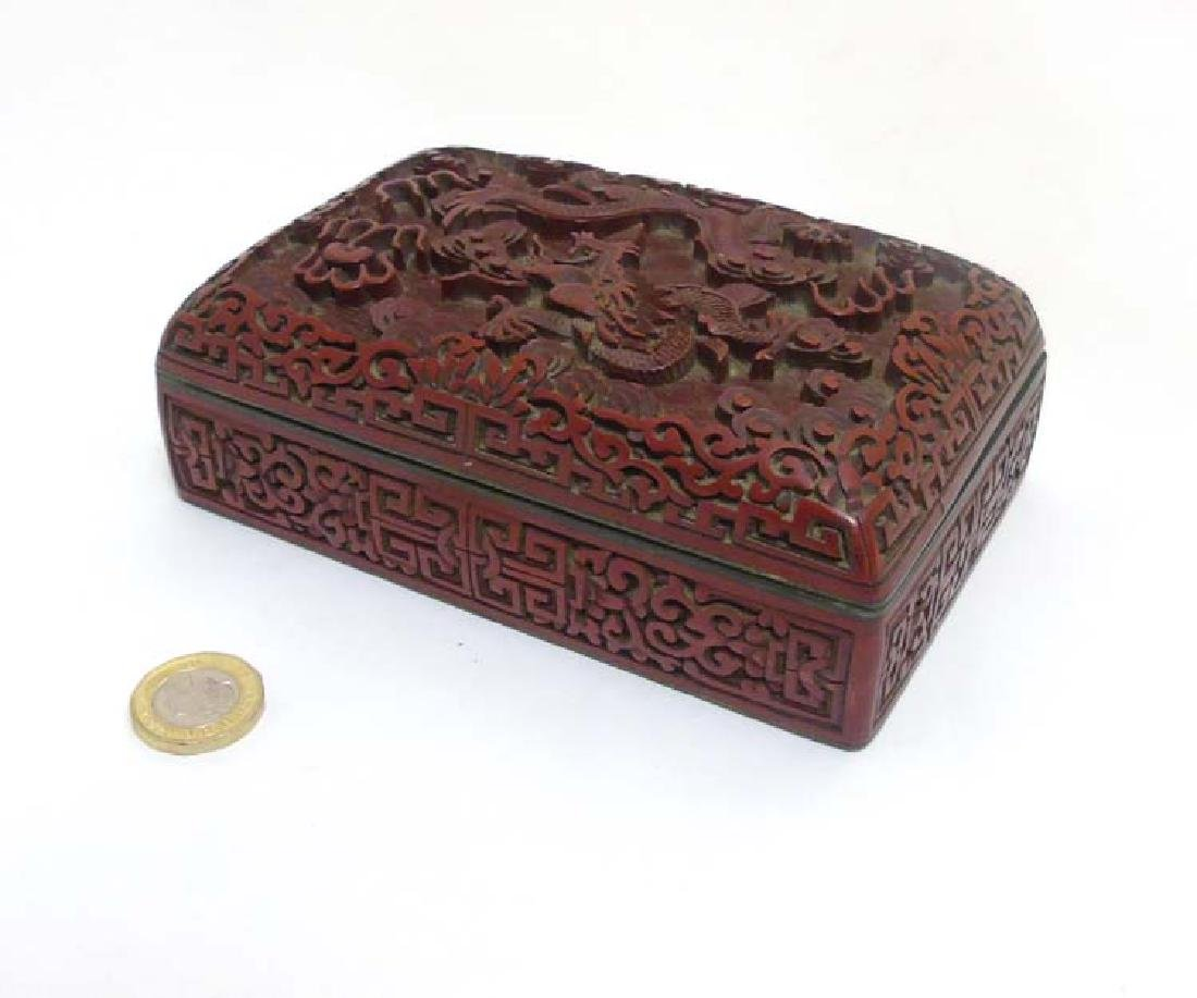 A Chinese carved cinnabar lacquer box depicting a 5