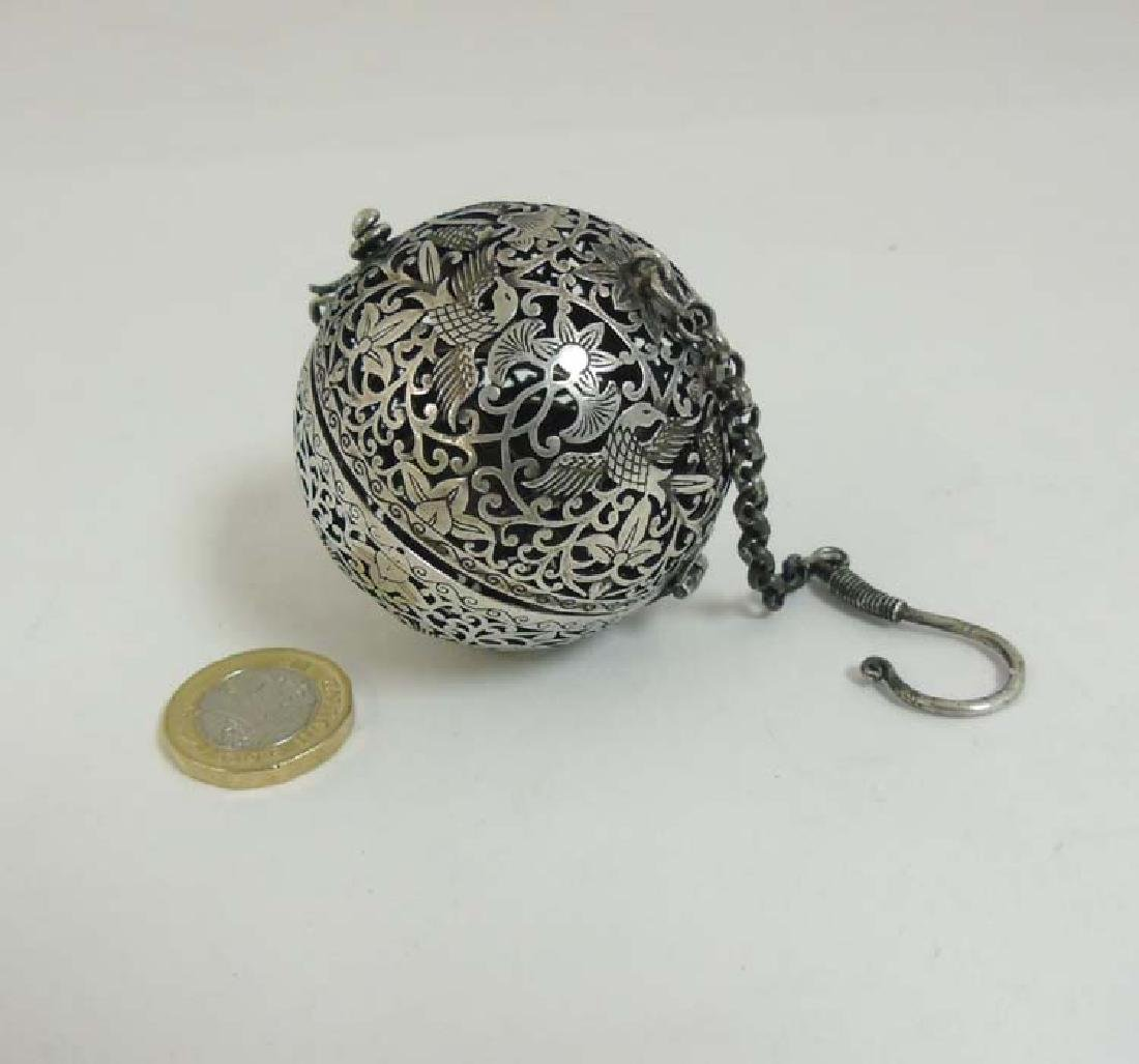 A Chinese white metal pomander of spherical form