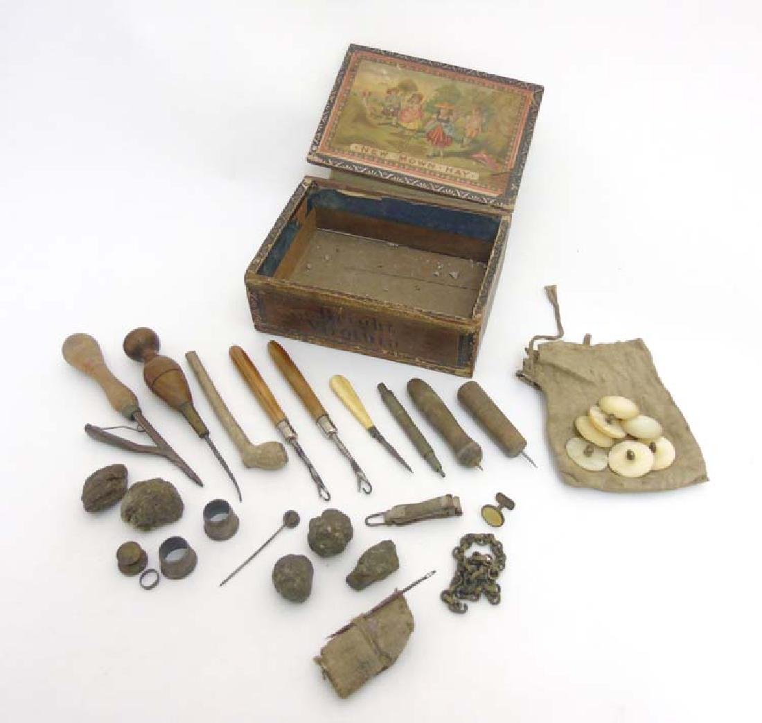 A box containing a quantity of leather workers tools