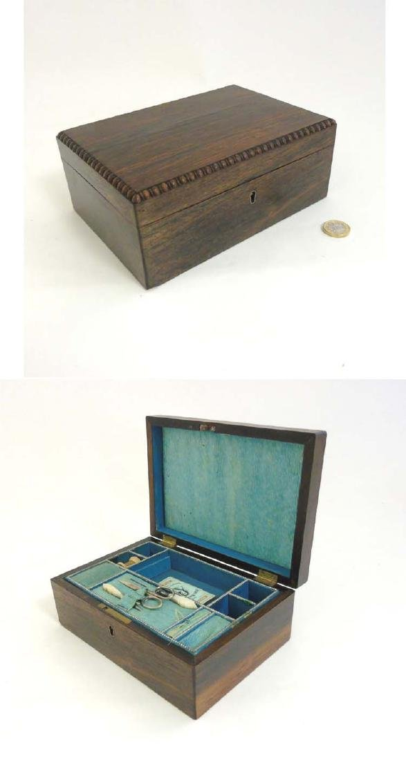 A late Regency Rosewood sewing box with silver thimble,