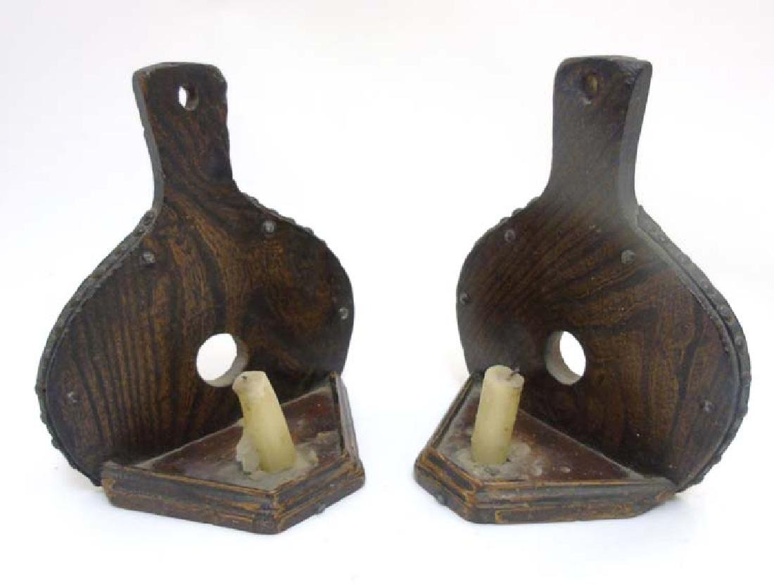 A pair of c.1900 oak wall mounted candle sconces in the