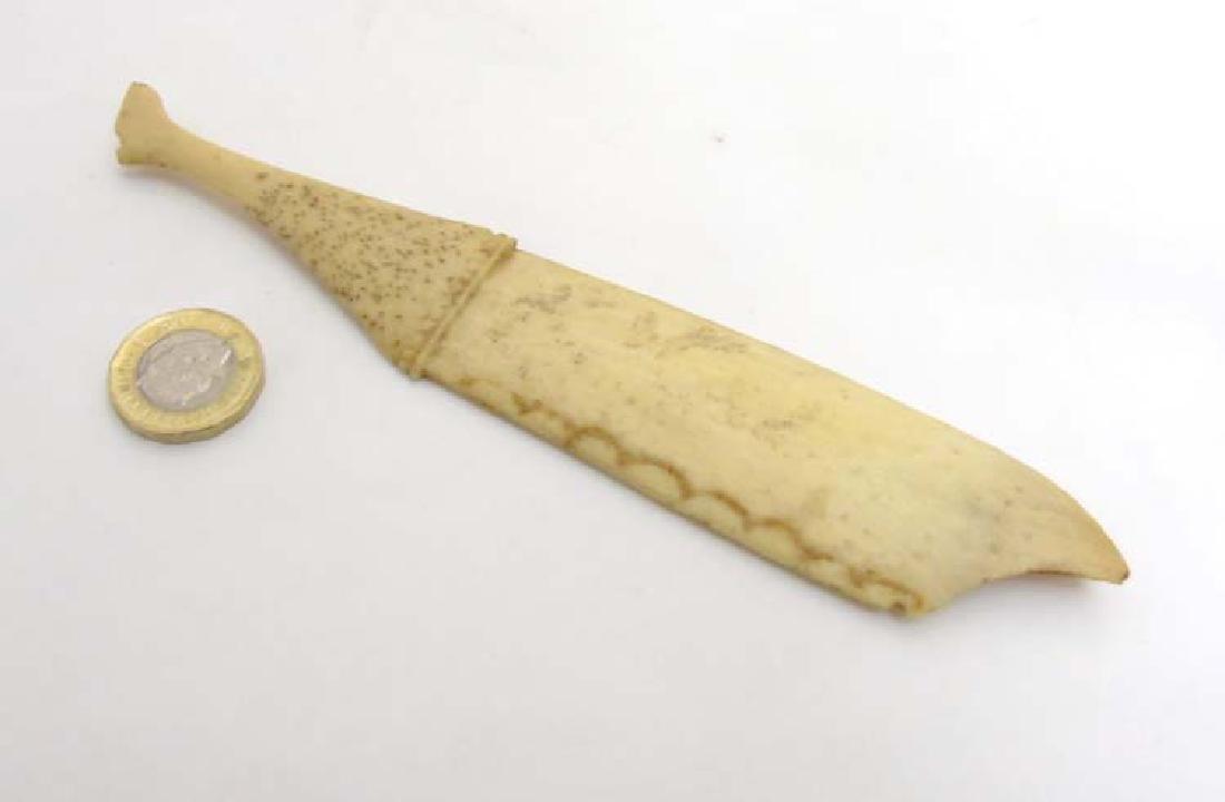 A novelty Victorian carved bone  paper knife / shoe