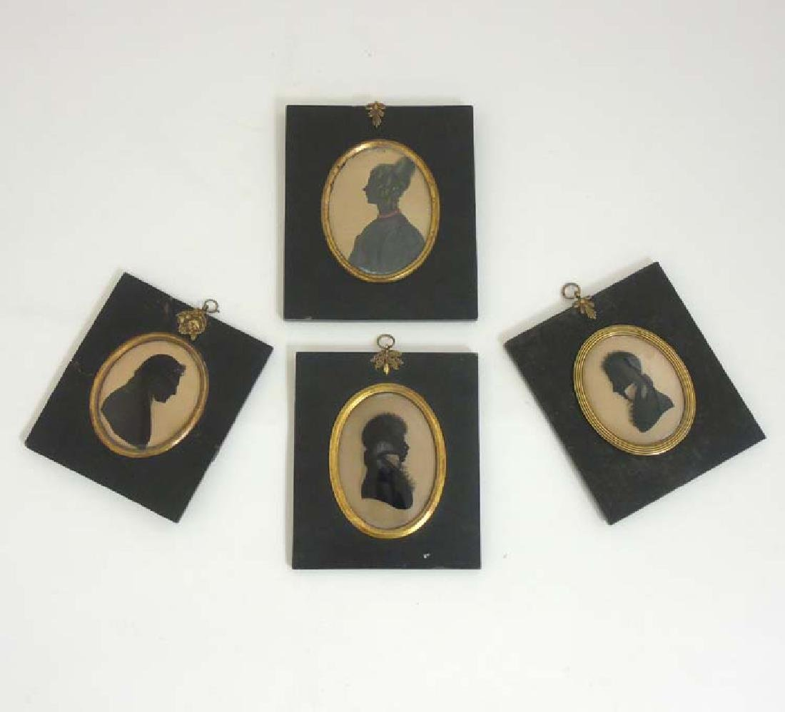19 th C Silhouettes : Four oval silhouettes , some