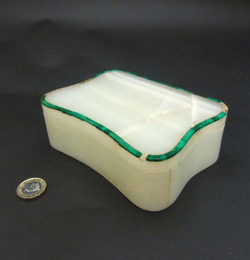 An Art Deco white onyx and malachite serpentine shaped