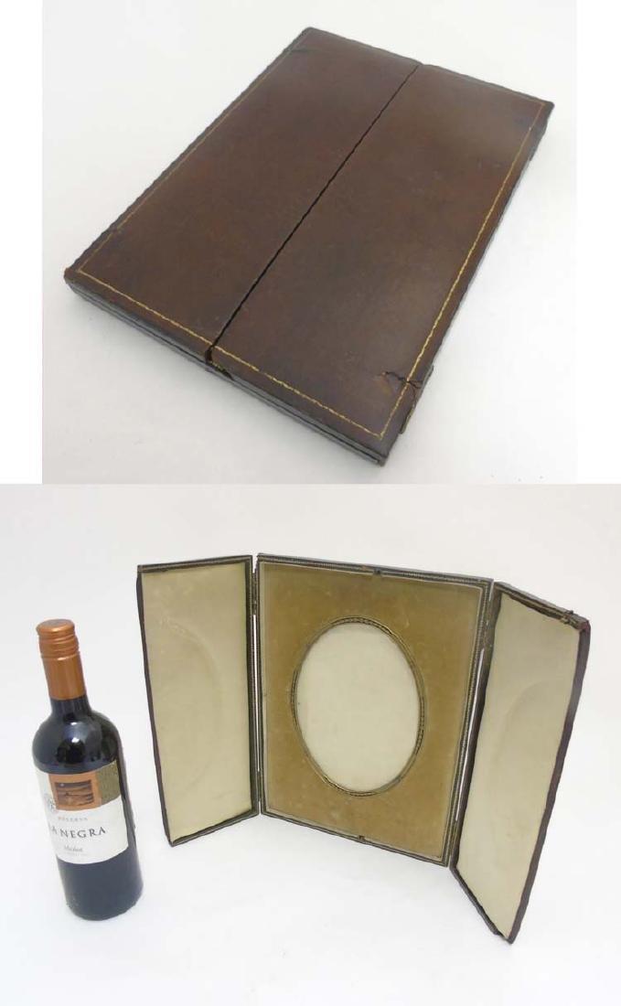 Debenham Gould Bournemouth : A leather cased folding