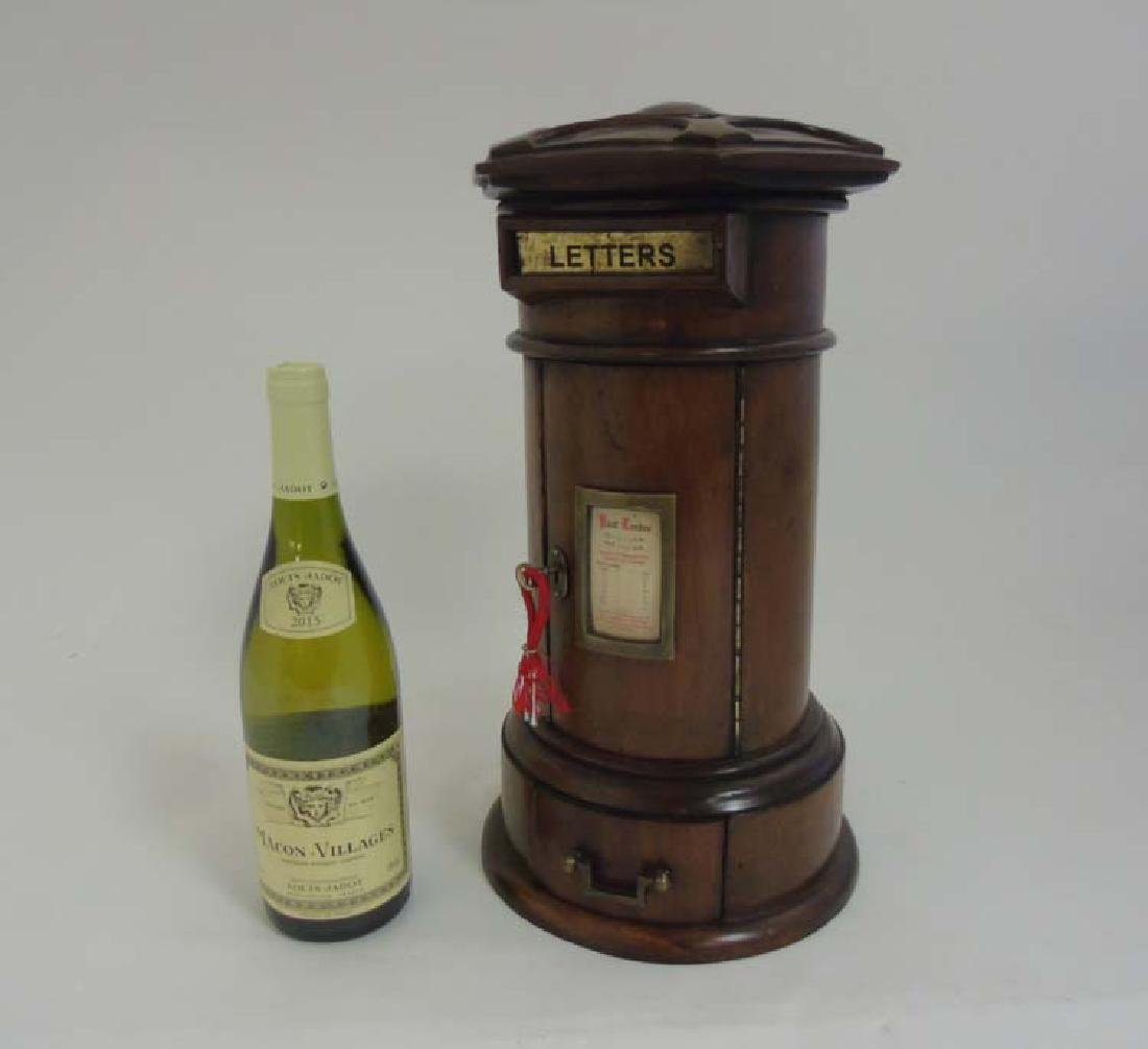 A 21stC Victorian style country house post box of