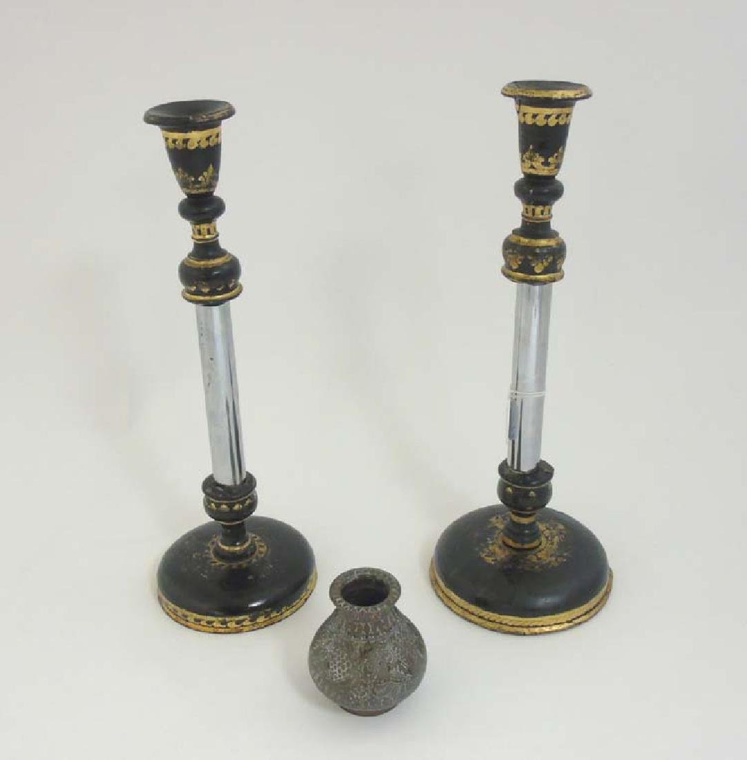 A pair of turned wooden candlesticks with black lacquer