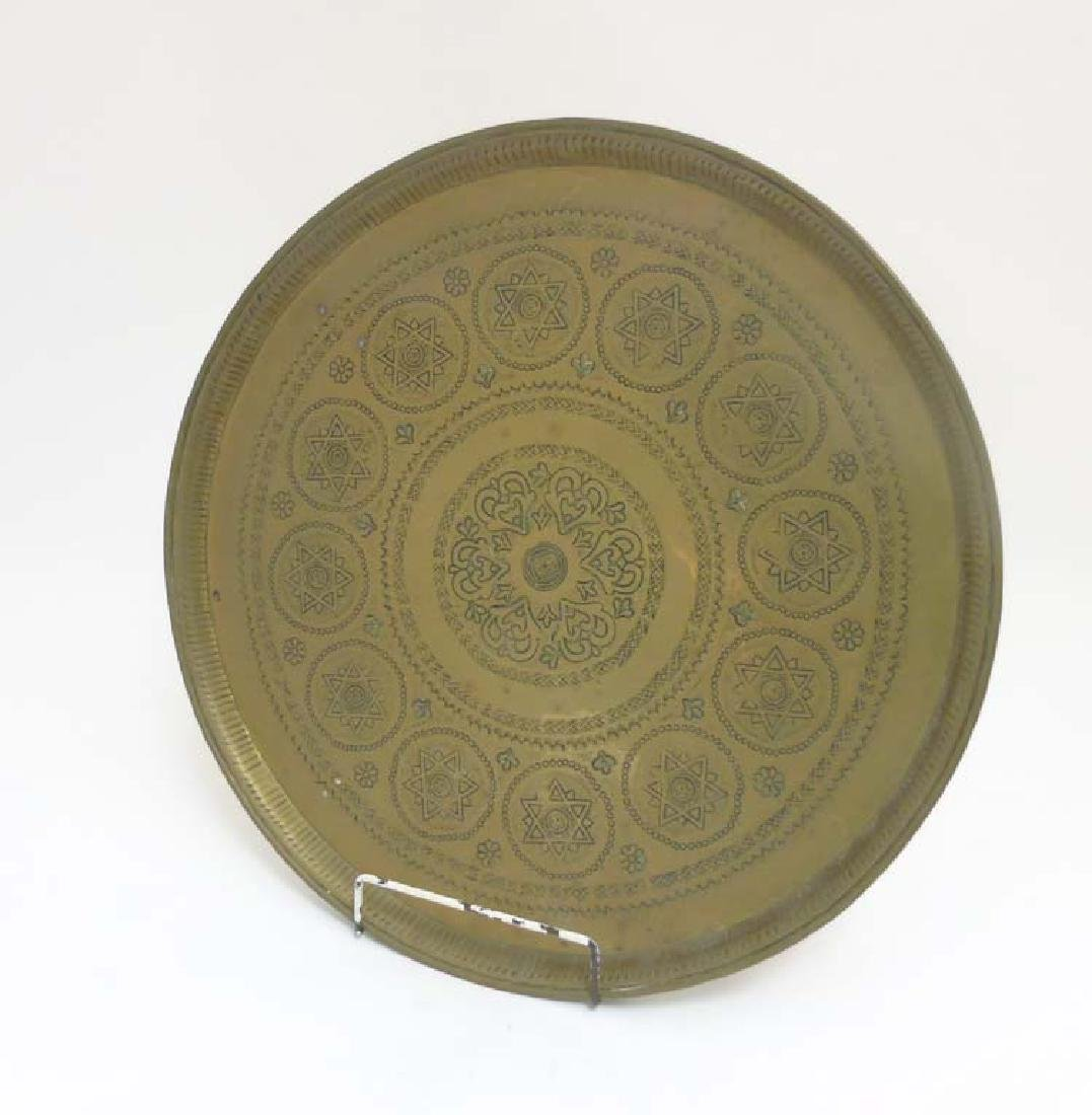 An early 20thC punchwork and cast brass Moroccan tray