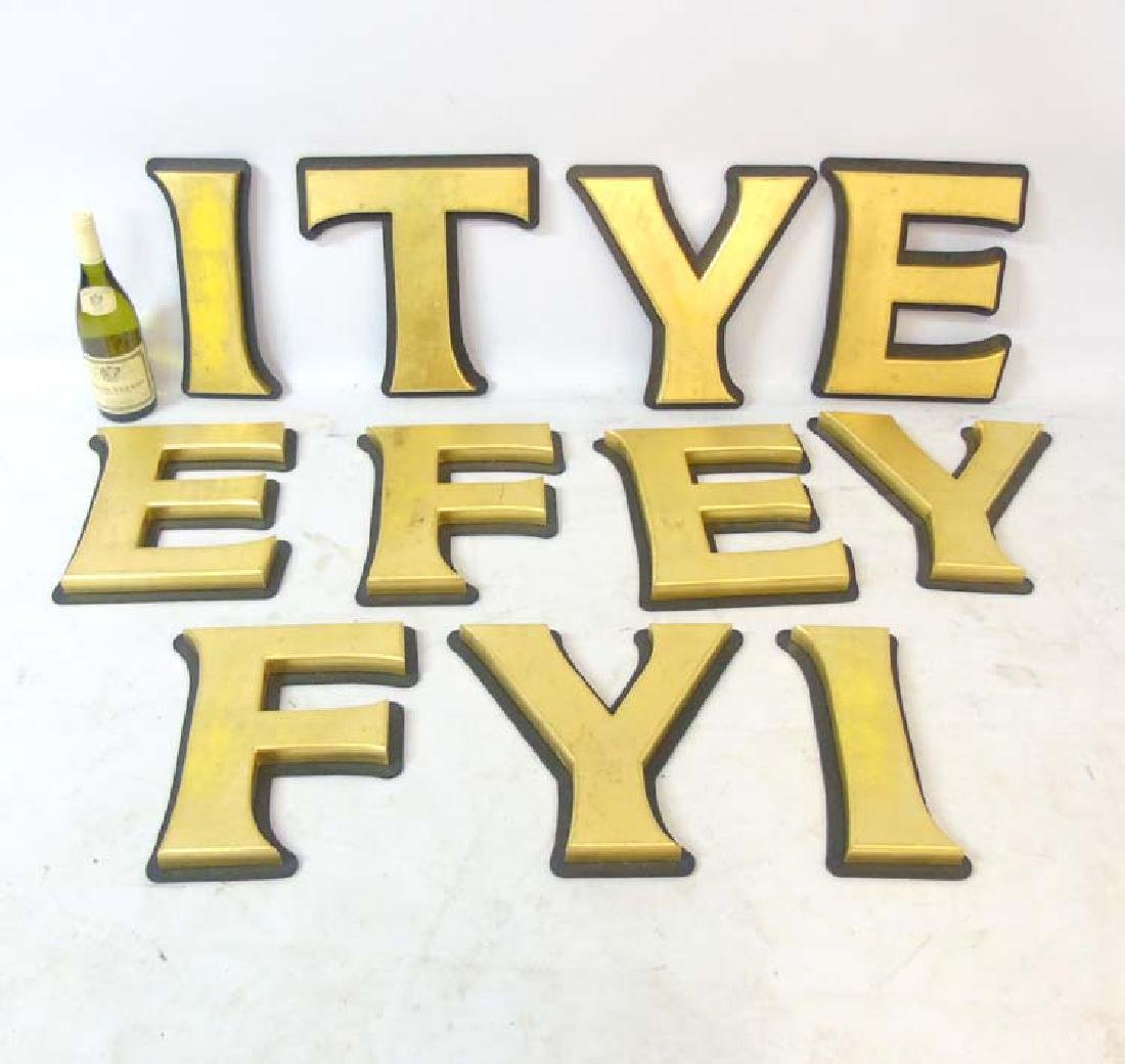 A collection of 11 large gilt coloured letters /