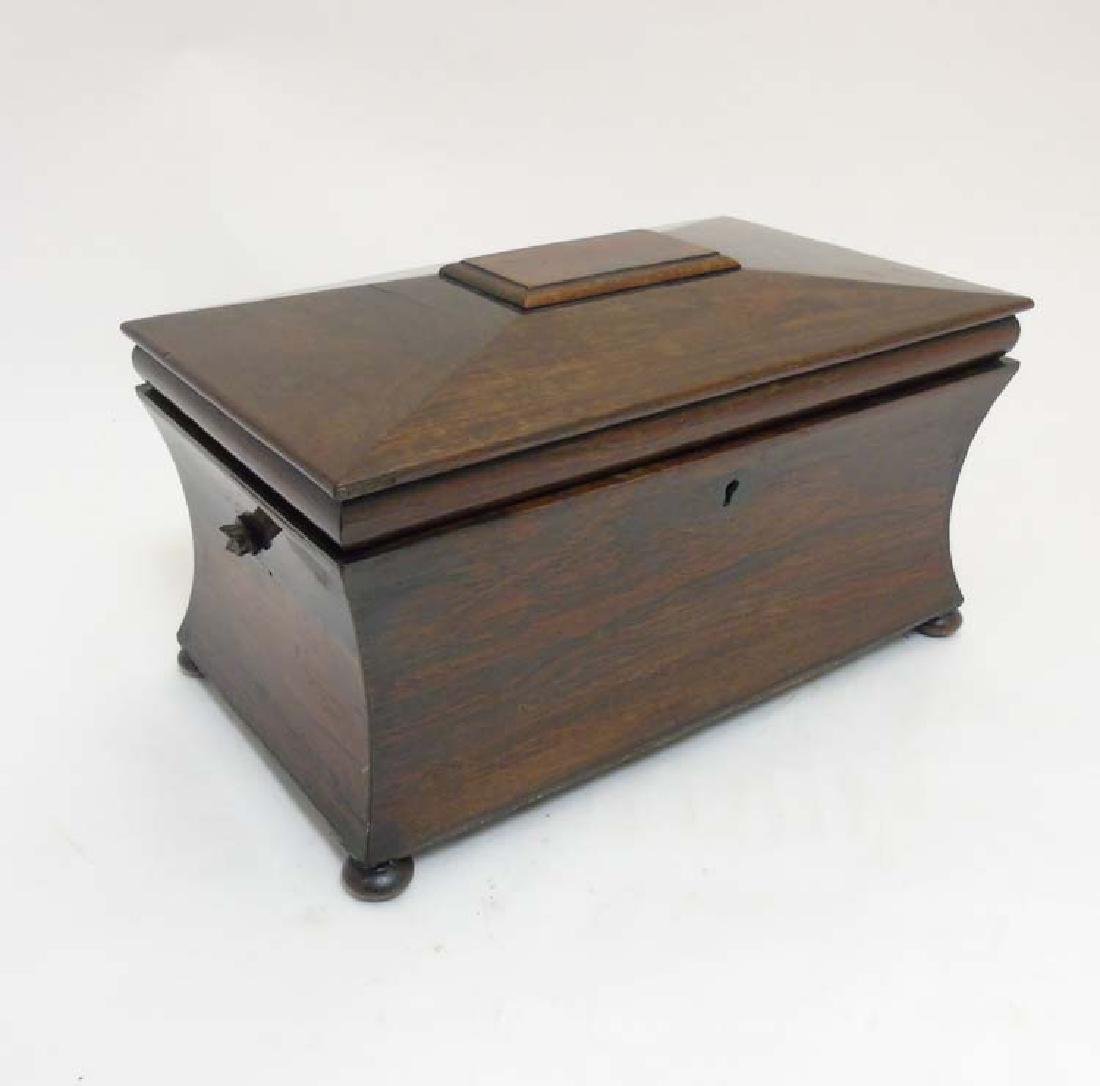 A Georgian Rosewood tea caddy of sarcophagus form with