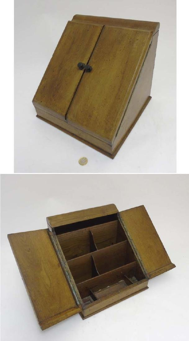 A c.1900 oak 2-door stationary box opening to reveal